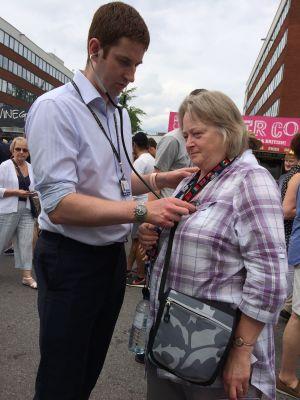 Stuart Grant gives a stethoscope exam.jpg